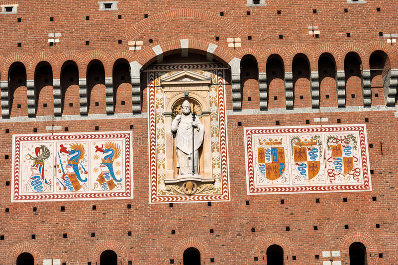 Sforza Castle in Milan Italy - Castello Sforzesco. Detail of the tower of Filarete clock tower with the coat of arms of the Visconti family. Sforza Castle XV stock photography