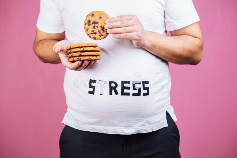 Sforzo, bulimia, eccesso di cibo compulsivo, obesità fotografie stock libere da diritti