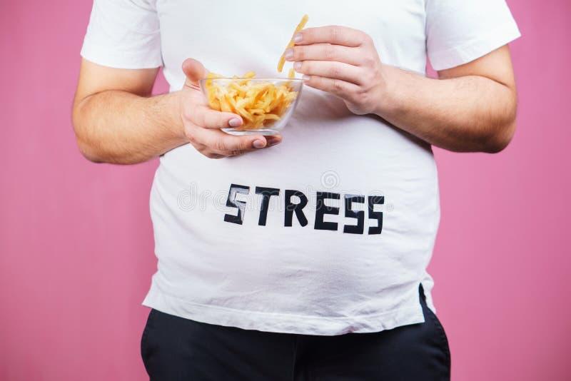 Sforzo, bulimia, eccesso di cibo compulsivo, obesità fotografie stock