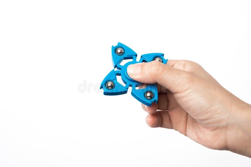 Sforzo del filatore del dito, giocattolo di sollievo di ansia su fondo bianco fotografia stock libera da diritti