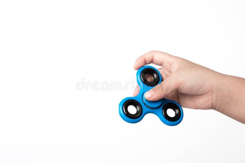 Sforzo del filatore del dito, giocattolo di sollievo di ansia su fondo bianco immagini stock libere da diritti