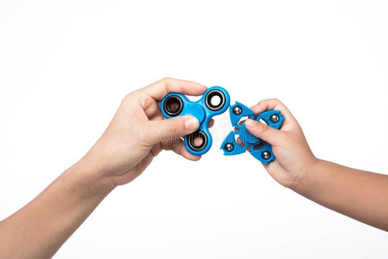 Sforzo del filatore di due dita, giocattolo di sollievo di ansia su backgroun bianco fotografia stock