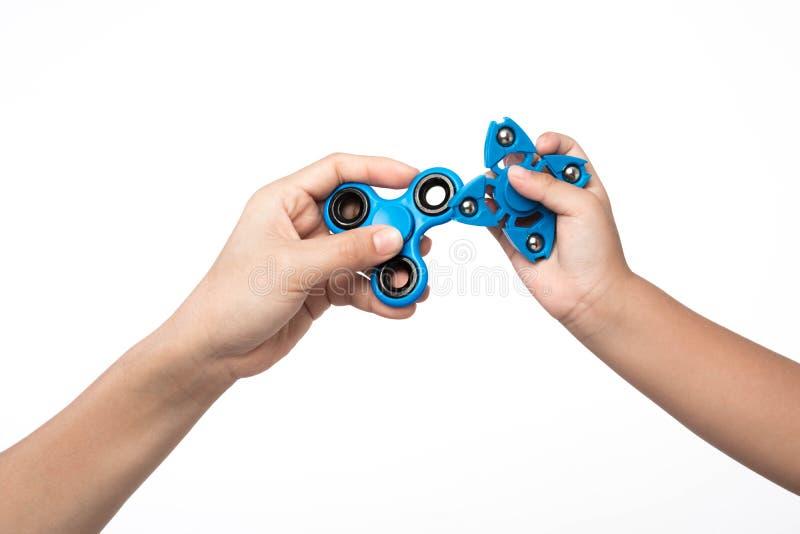 Sforzo del filatore di due dita, giocattolo di sollievo di ansia su backgroun bianco immagine stock