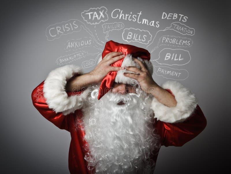 Sfrustowany Święty Mikołaj Boże Narodzenia i wiele problemy fotografia stock