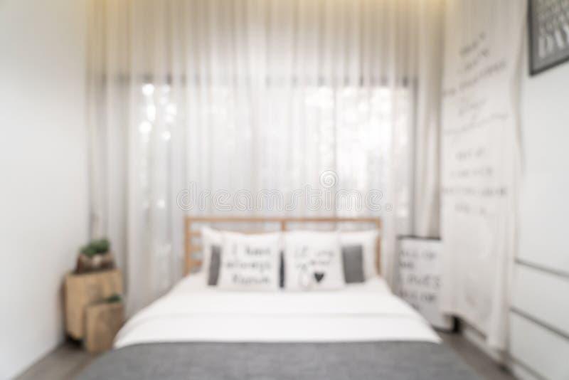 Sfuocatura astratta ed interno defocused della camera da letto immagini stock
