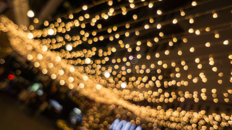 Sfuocatura di vita di notte di Bokeh e defocus, festival a Bangkok Tailandia fotografia stock