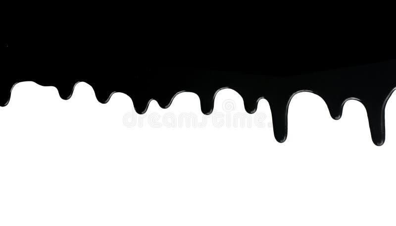 Sgocciolatura nera della vernice sul bianco immagini stock libere da diritti