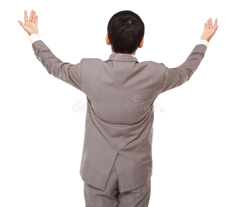 Sguardi dell'uomo d'affari indietro che sono mani sollevate verso l'alto fotografia stock