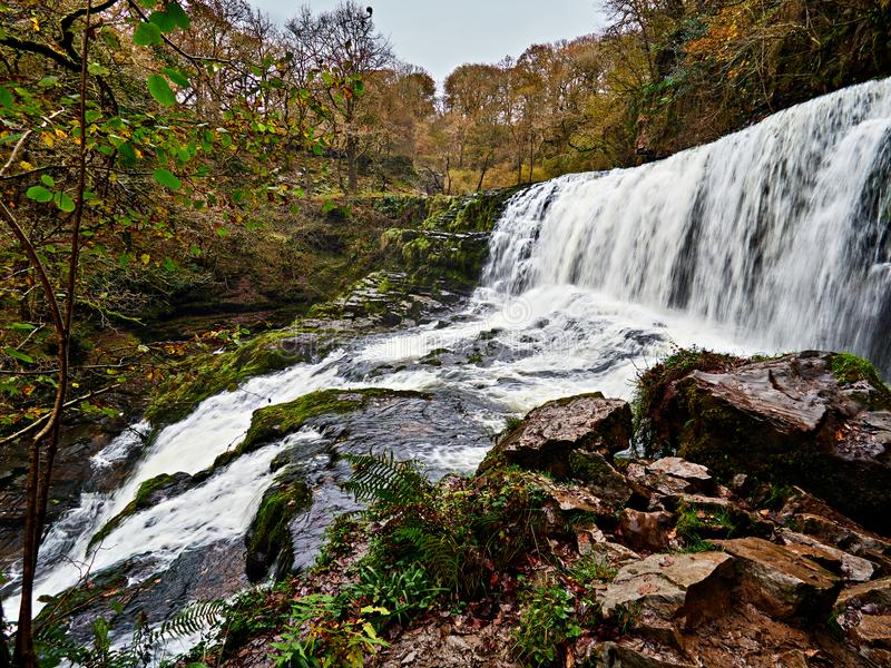 Sgwd Isaf Clun-gwyn Waterfall Ystradfellte Wales. Sgwd Isaf Clun-gwynor Lower Fall of the White Meadow is one of the four main waterfalls on the Afon or River stock image