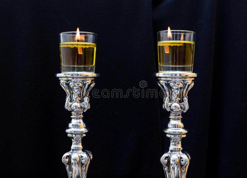 Shabbat candles. Silver candlesticks with olive oil. Made of pure silver stock images
