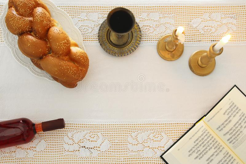 shabbat image. challah bread, shabbat wine and candles on the table. Top view. stock photography
