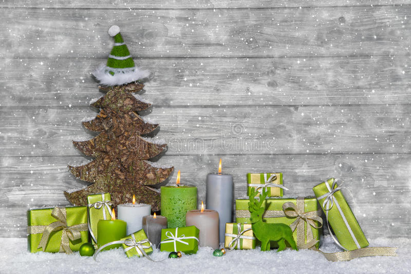 Shabby chic green and white christmas decoration on grey wooden royalty free stock photography
