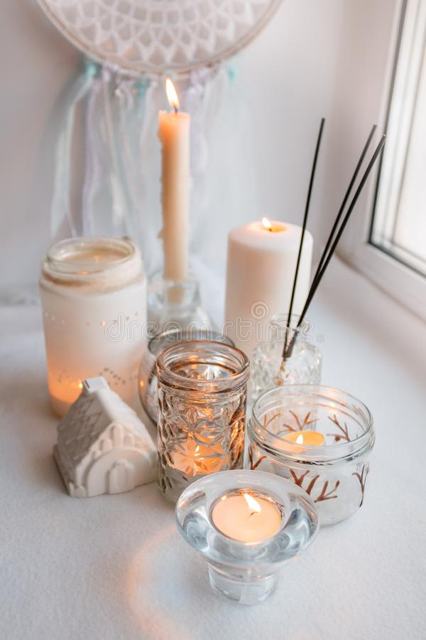 Shabby chic home design. Beautiful decoration table with a candles, dreamcacher and aroma stick, mindfullness relax concept. Shabby chic home design. Beautiful stock image