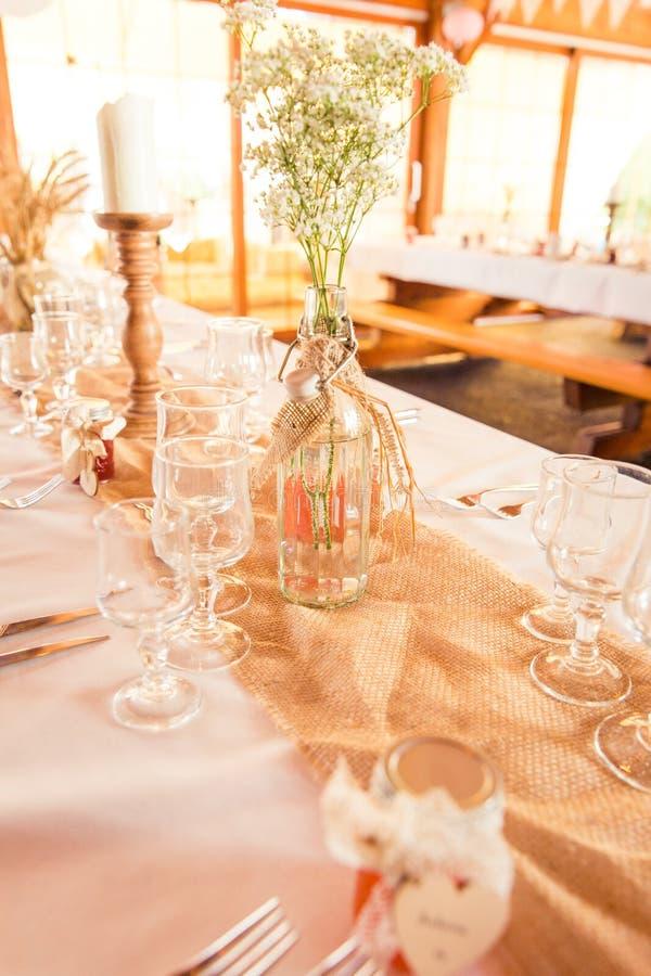 Shabby Chic Rustic Wedding Table Burlap and Gypsophila Decoration royalty free stock photo