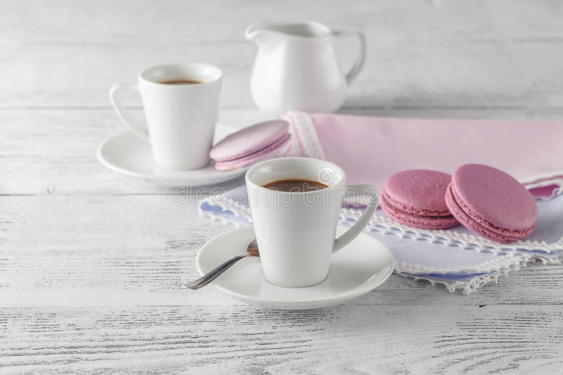Shabby chic style coffee cup and plate with macaroon cookie stock images