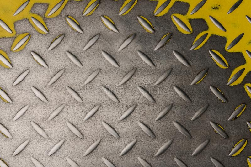 Metal grooved plate with yellow color stock photos