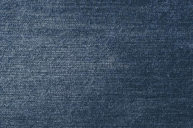 Shabby dark denim. Blue jeans background. Fabric pattern surface. Old, retro style of jean clothes. Vintage, fiber, textile textur stock photos