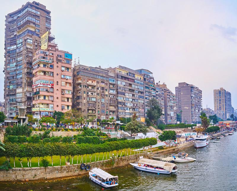 Shabby high-rises of Doqi neighborhood, Giza, Egypt. GIZA, EGYPT - DECEMBER 19, 2017: The line of old shabby living high-rises of Al Doqi neighborhood stock image