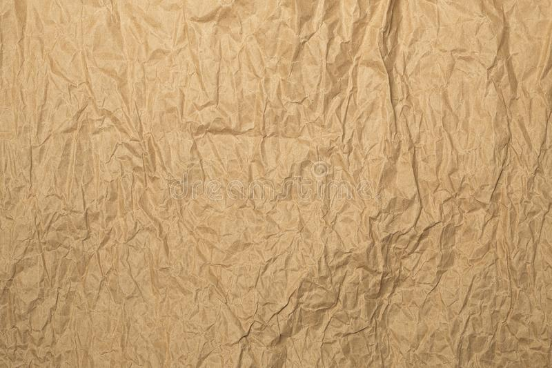 Shabby light brown kraft paper background. In evening sunlights royalty free stock image