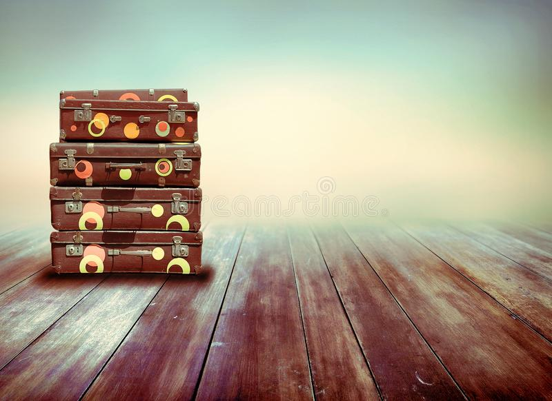 Shabby Vintage Ancient Suitcases. Background of wooden boards. stock illustration