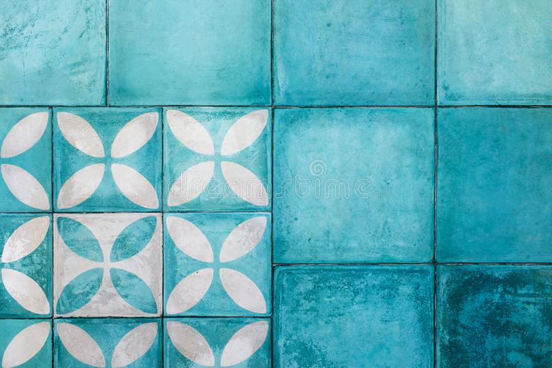 Shabby vintage blue square tile on floor. Shabby blue square tile on floor. Turkish or moroccan vintage style ornament. Empty textured background. Modern stock images