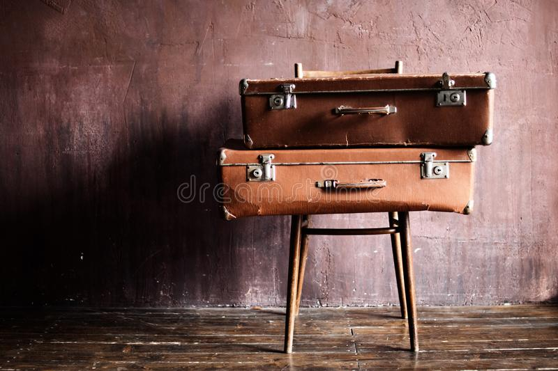 Shabby Vintage Stacked Ancient Suitcases Travel royalty free stock images