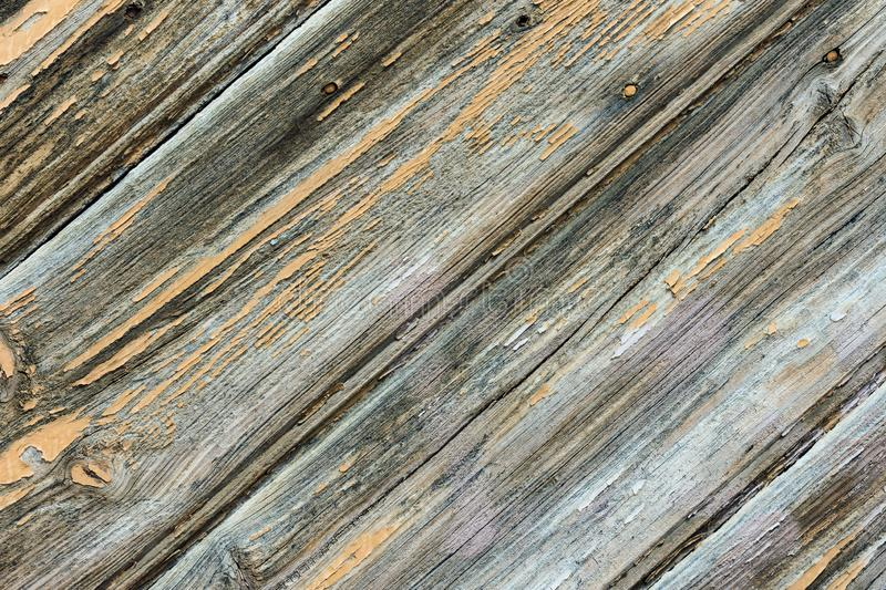 Shabby weathered plank wood background. Geometrical graphic diagonal pattern fragment of old gates door. Gradient gray color hues stock images