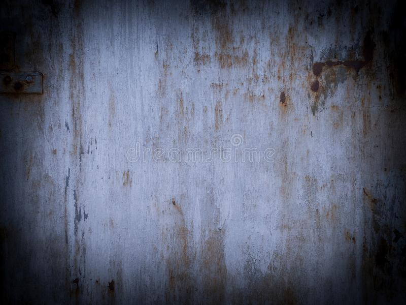 Shabby white painted metal surface with vignette stock images
