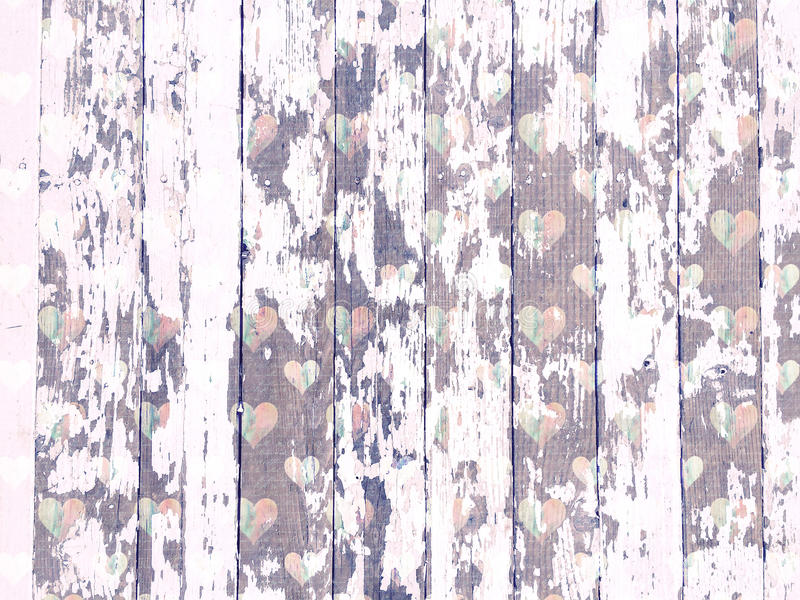 Shabby wood-grain texture white washed with distressed hearts pattern. Shabby distressed wood-grain peeling paint texture white washed with heart pattern stock photo