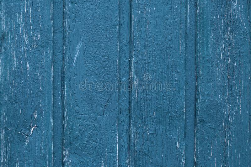 Shabby wood texture background. Vintage wooden painted fence. Blue shabby planks, desk surface. Weathered timber. Old boards. stock photography