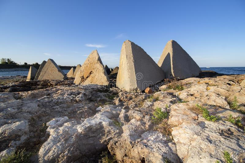 Seascape. Composition of rocks and concrete pyramids. Shabla municipality is the most eastern municipality of Bulgaria. The length of the coast is about 40 km royalty free stock image