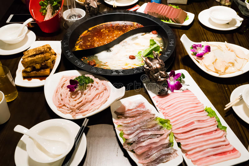 The shabu pot in Chinese style - pork soup and oily spicy soup stock photography