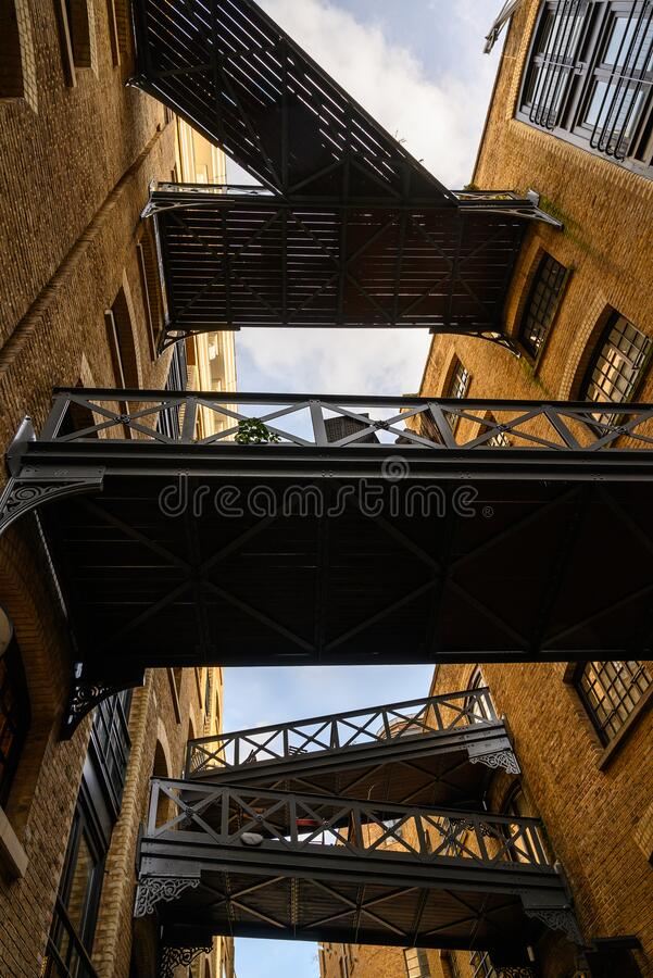 Shad Thames in London, UK. Historic Shad Thames is an old cobbled street known for it`s restored overhead bridges and walkways. This old street is in royalty free stock photos