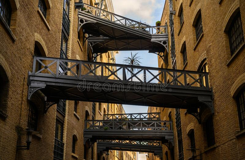 Shad Thames in London, UK. Historic Shad Thames is an old cobbled street known for it`s restored overhead bridges and walkways. This old street is in stock photo