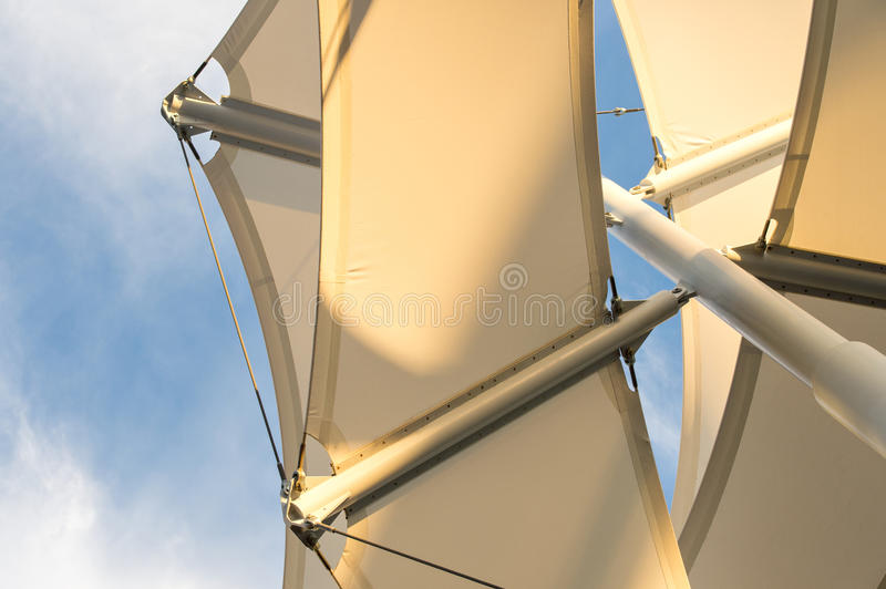 Shade Sail Structure. Canopies anchored to steel structures provide shade at an outdoor pavilion royalty free stock photography