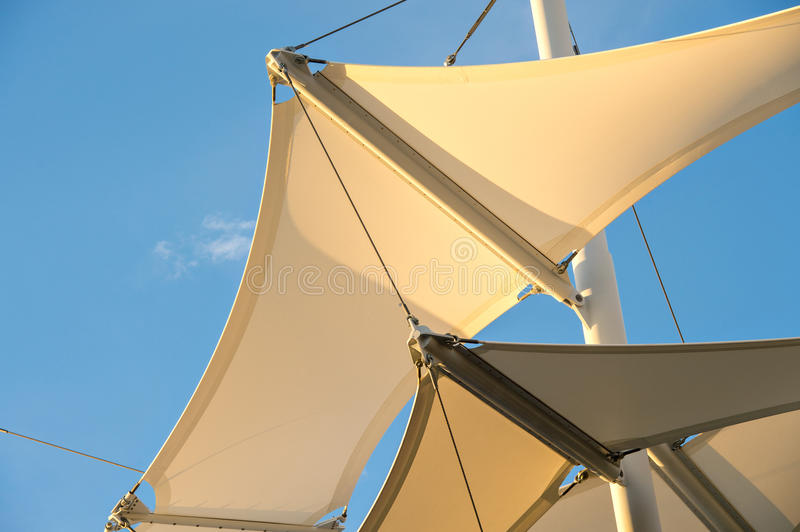 Shade Sail Structure. Canopies anchored to steel structures provide shade at an outdoor pavilion stock photos