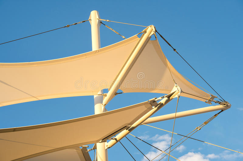 Shade Sail Structure. Canopies anchored to steel structures provide shade at an outdoor pavilion royalty free stock photos