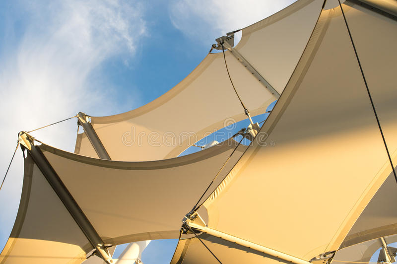 Shade Sail Structure. Canopies anchored to steel structures provide shade at an outdoor pavilion stock image