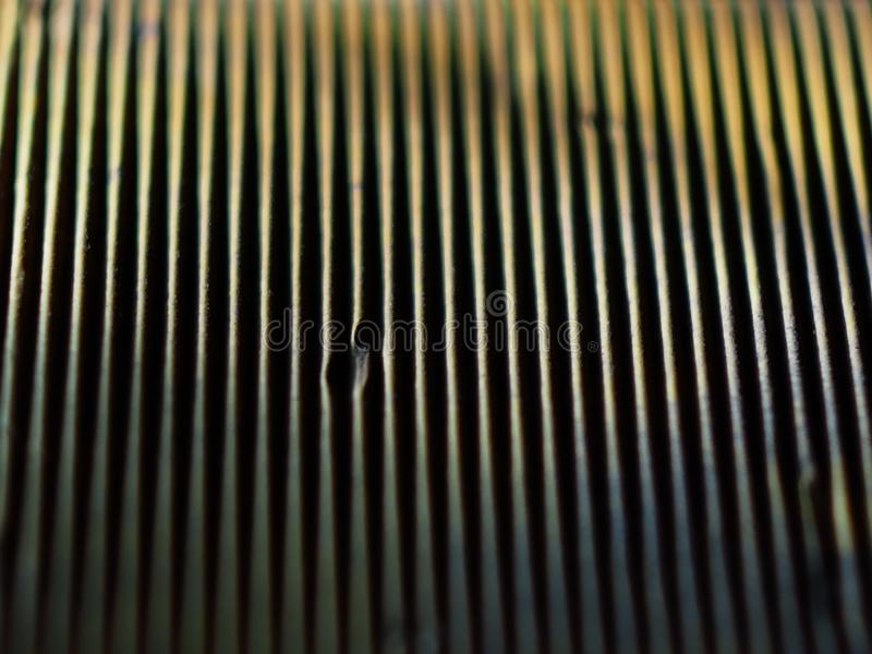 Yellow corrugated paper interesting texture. From the shade of the strip caused by the lighting of the sun yellow paper interesting substrate under the text or royalty free stock photo