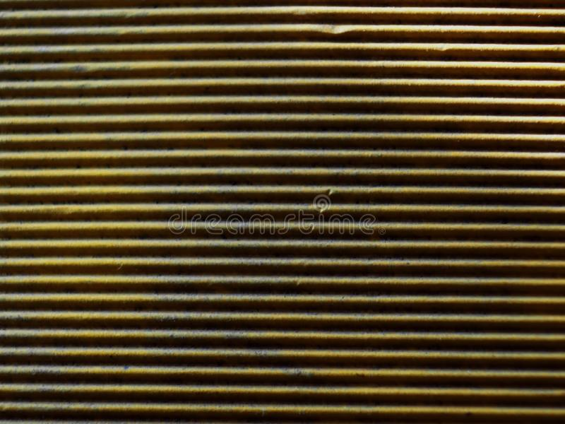 Yellow corrugated paper interesting texture. From the shade of the strip caused by the lighting of the sun yellow paper interesting substrate under the text or stock photo