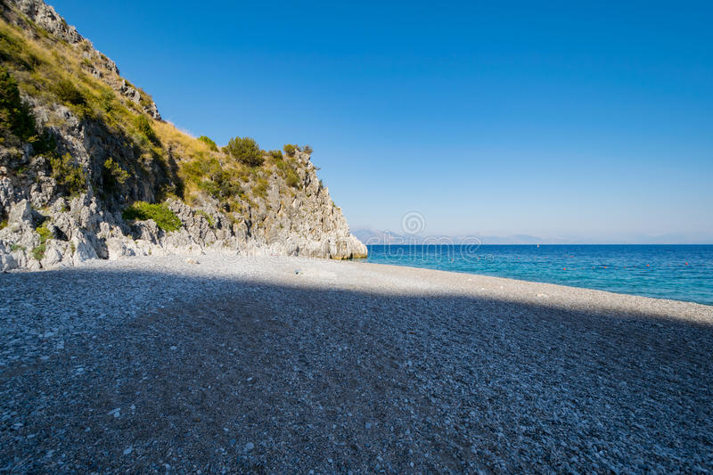 Shaded beach. A shaded beach without people at the afternoon light royalty free stock photo