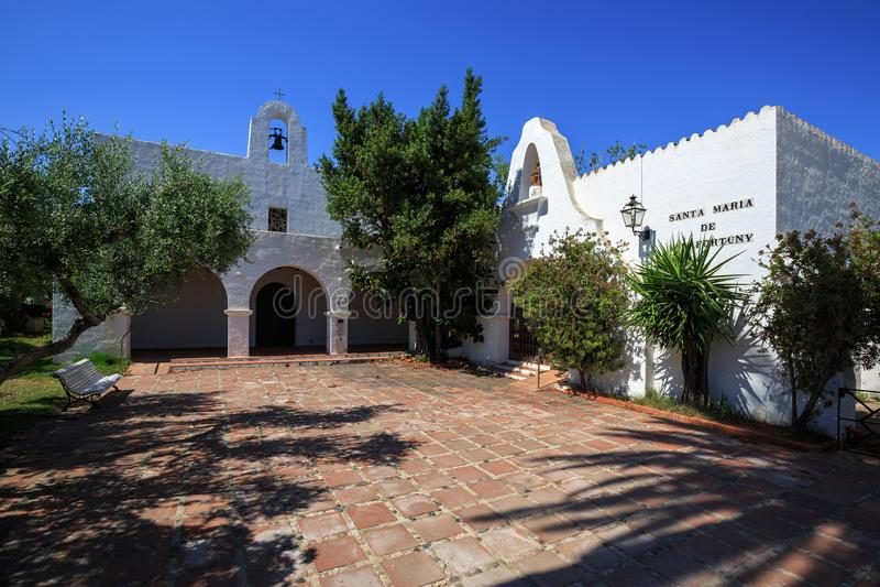 Shaded courtyard of the church of Santa Maria de Vilafortuny. Cambrils, Spain. stock photos