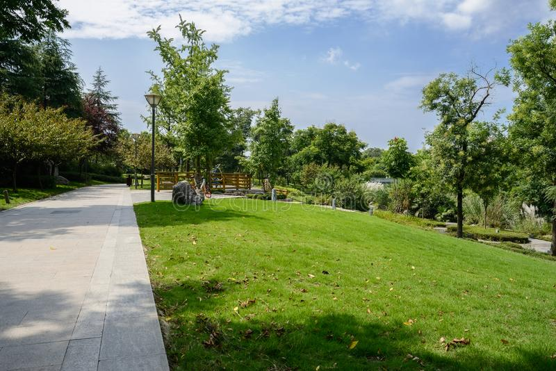 Shaded footpath in lawn on sunny summer day. Shaded footpath in the lawn on sunny summer day,Chengdu,China royalty free stock image