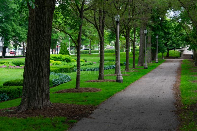 Shaded Green Path in Grant Park Chicago. A shaded green path with green trees and grass in Grant Park Chicago royalty free stock photography