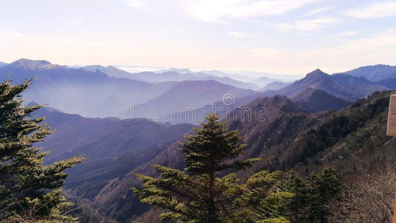 Shaded japanese mountains. Asia travel, Japan, Shikoku island, Ishizuchi San hike, amazing trekking, incredible shade of colors that marks the crest of different stock photo