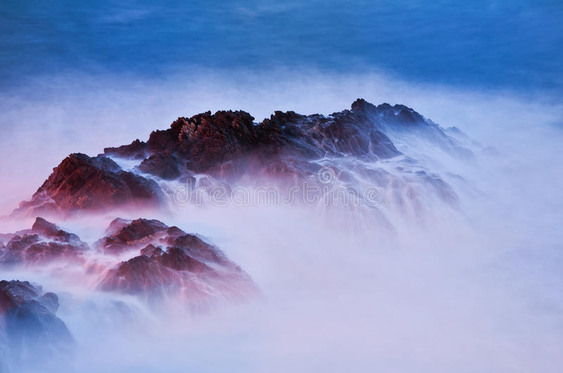 Shaded rocks from the sea. Shaded rocks by the waves of the stormy sea of the night arrival royalty free stock images