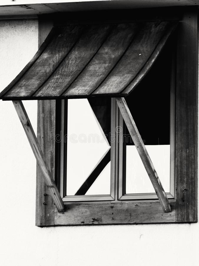 Shaded View. A black and white shot of a window with a shade over it royalty free stock image