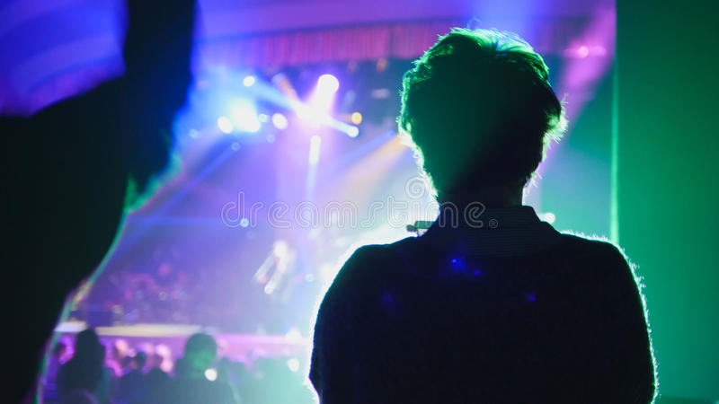 Shadow of adult woman at the concert in the club, blurred royalty free stock photography