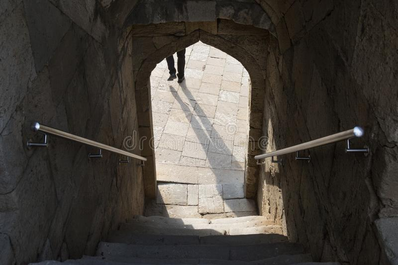 Shadow in the arch doorway,stairs down the entrance through the arch, steps stock photography