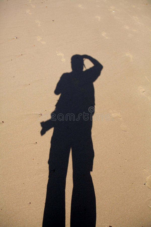 Shadow on the beach royalty free stock images